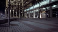 Courtyard of glass building in city video