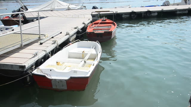 cove with old fishing boat in water video