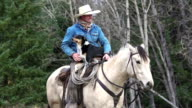 Cowboy on horseback with his cattle dog video