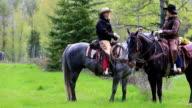 Cowgirls on horseback talking video