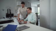 Coworkers get together before meeting in the morning video