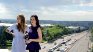 Co-working females are talking about work standing on roof video