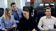 Co-working males and female are having work meeting video