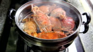 Crabs stream cooking in kitchen video