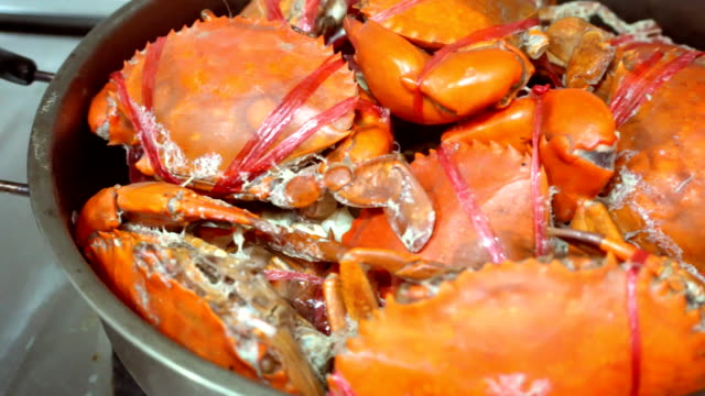 Crabs stream in pod, cooking in kitchen video