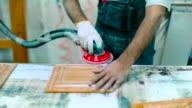 Craftsman polishing furniture details video