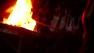 Craftsman working furnace in blacksmith's shop Slow motion video