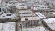 Crane arm swinging around while constructing high rise video