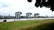 Crane Houses. Cologne's modern architecture Kranhäuser disappears behind tree. Skyline. Tracking shot. Long shot. video