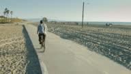 Crane Shot of Man with Prosthetic Limb Riding Bike video