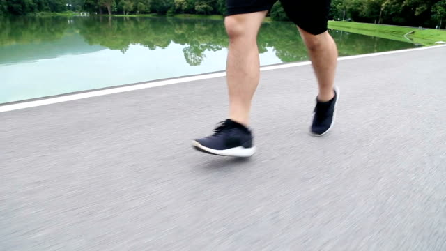 Crane shot of runner from running shoes to head video