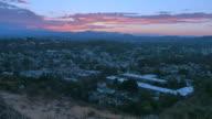 Crane Shot through Tall Grass Overlooking Distant Hills and Purple Sky Sunset video