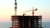 Cranes at a skyscraper construction video
