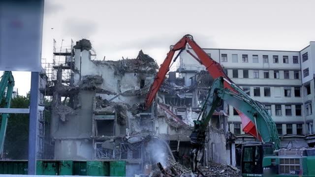 Cranes demolishing a highrise building video