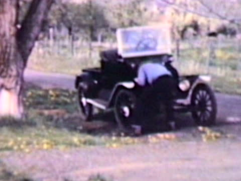 Crank start old car-From 1950's film video