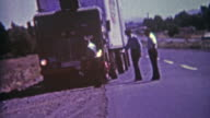 1964: Crashed cop car needs a tow from roadside ditch after police chase gone horrible. video