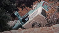 CANYONLANDS, UTAH -1971: Crashed Jeep automobile and flipped over from technical offroad trails. video