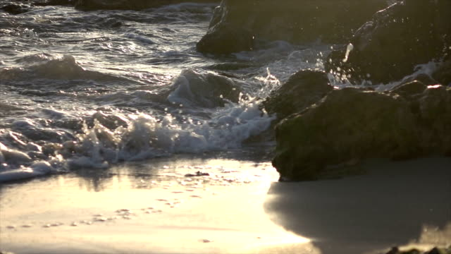 Crashing Waves Painted Gold by Sunset video