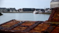 Crates in the harbor in Trouville, France video