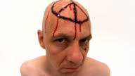 Crazy Bald Man with bloody peace sign video