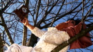 Crazy Dark-Haired Woman In Long White Nightie Laughing Lying On Tree video