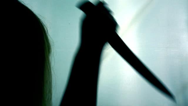Crazy female killer stabbing victim multiple times,  blood-chilling horror scene video