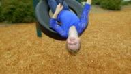 Crazy little girl looks upside down video