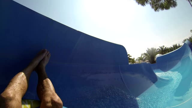 Crazy Race on the water slide in the water park. Slow motion. video