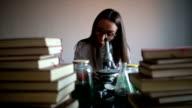 Crazy woman chemist in lab video
