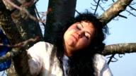 Crazy Woman Sitting On Tree video