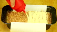 Cream pouring on dessert crumbs video