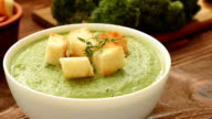 Cream - soup with broccoli in white bowl video