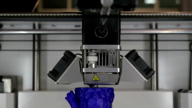 Creating object from blue plastic with 3D printer video