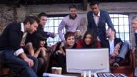 Creative group watching monitor video