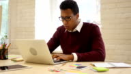 Creative Man Working in Office on Laptop video