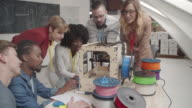 4K: Creative People Working By 3D Printer. video