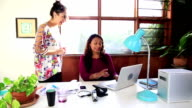 Creative studio young business woman asks advice older woman video