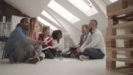 4K: Creative Team Brainstorming On The Floor In Their Office. video