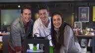 4K SLOW MOTION: Creative team posing near a 3D printer video