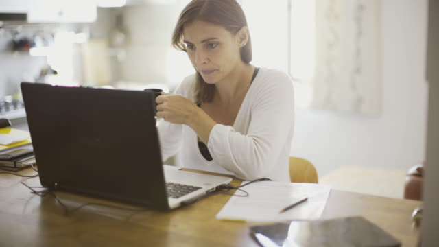 Creative woman working at home video