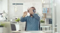 Creative Young Developer Uses Virtual Reality Glasses while Sitting at His Desk in His Office. video