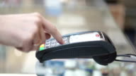 Credit Card Machine, paying with a credit card video
