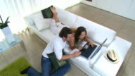 Credit card online young couple in modern home video