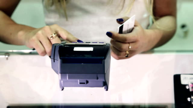 Credit card payment terminal in store. video