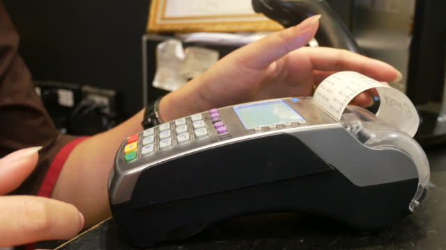 Credit card reader printing out the slip video