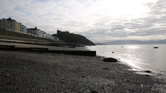Criccieth North Wales UK early morning sea lapping shore video