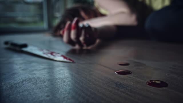 4K Crime Scene Knife and Dead Body Finger Moving video