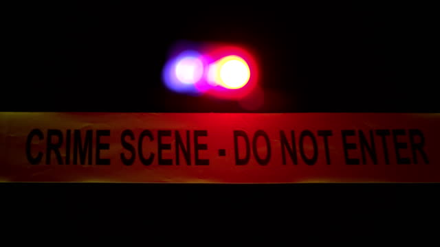 4K: Crime Scene Police Tape with sirens behind video
