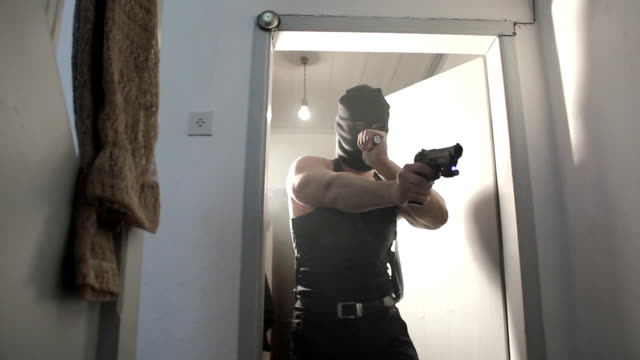 Criminal man with mask and gun video