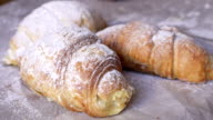 Croissants dusted with powdered sugar. video